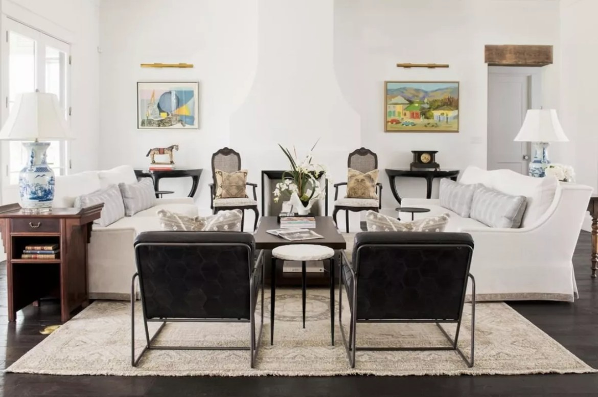 Neutral classic living room with two black chairs in metal frames.