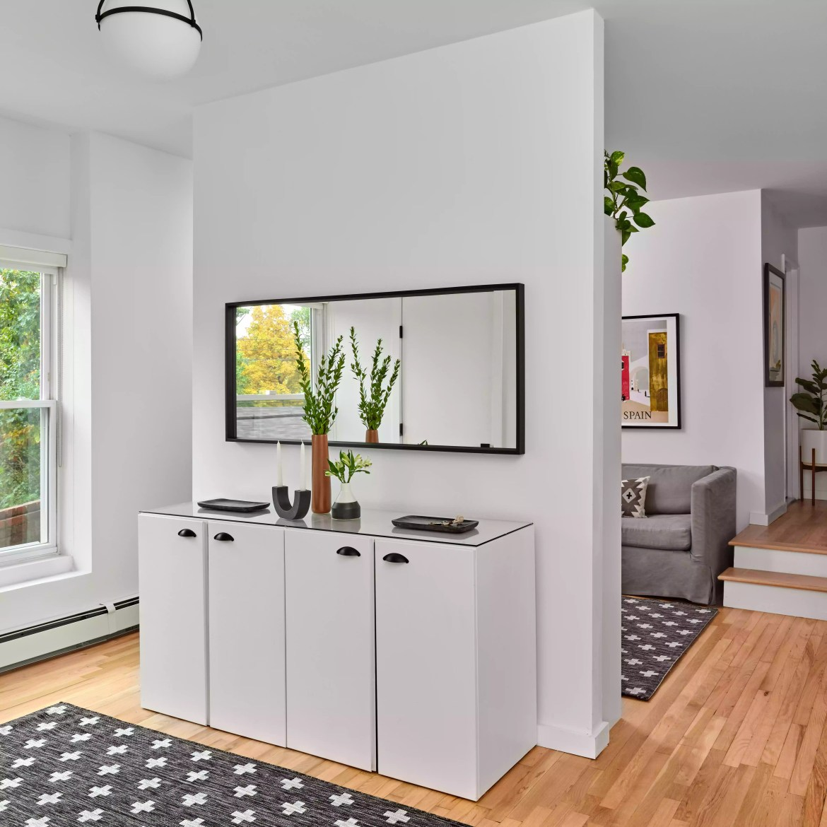 Modern simplistic entryway with curved vase.