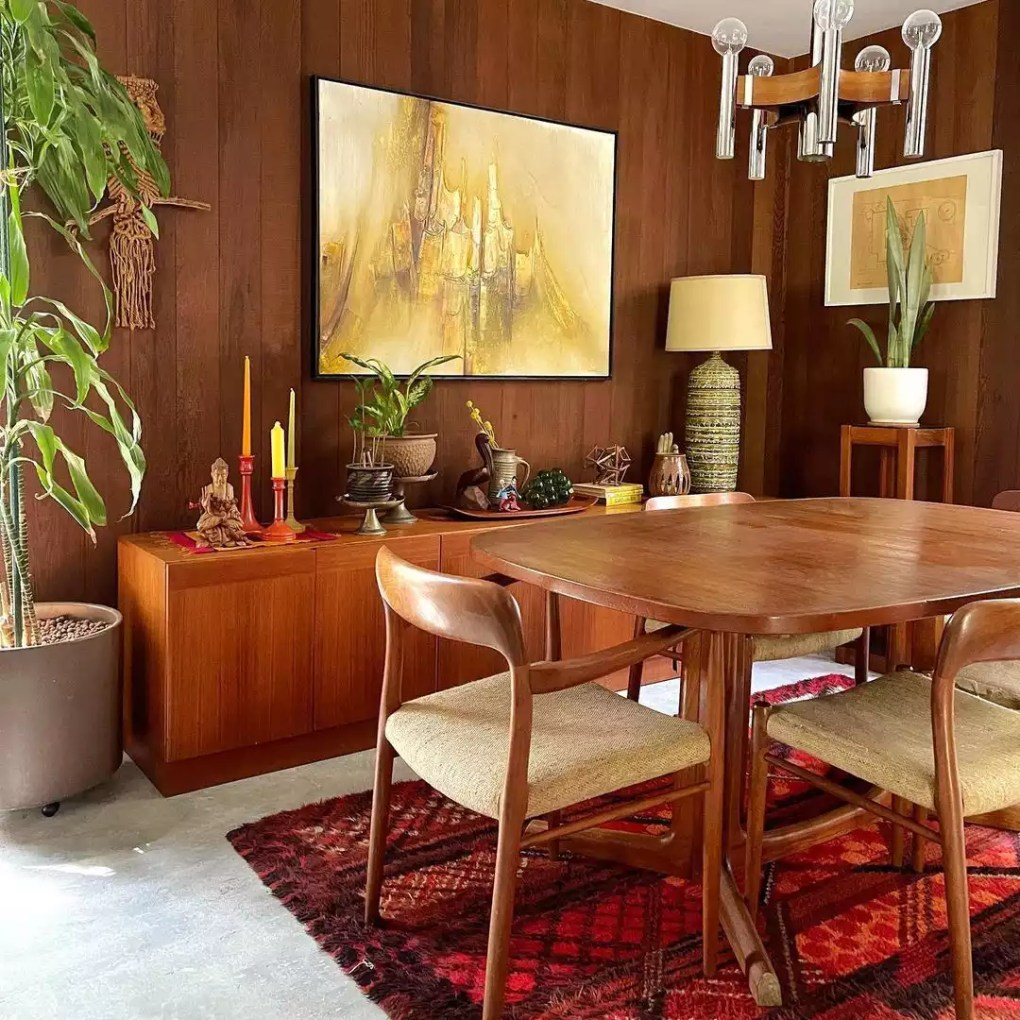 A retro dining room with wood paneling