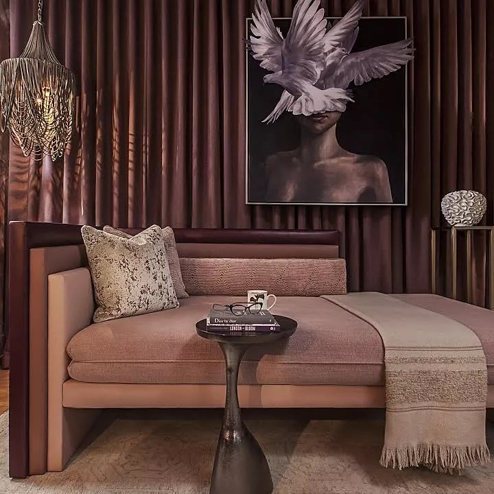 Luxurious living space with feathers and chaise.