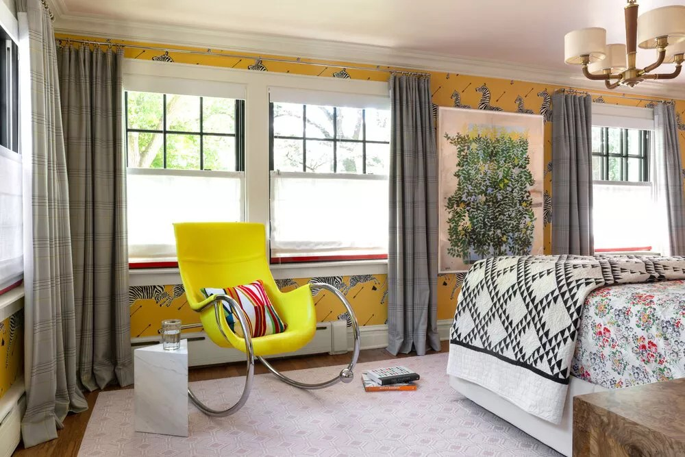 Bold yellow accent chair with metal handles.