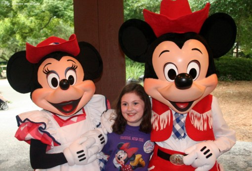 "Sophie surrounded by two of her favorite ""M""s -- Minnie and Mickey!"