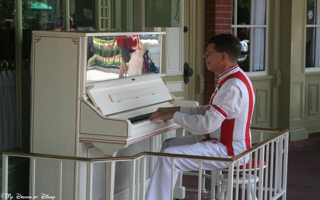 Our piano player looks like he loves his job! This is right outside of Casey's.