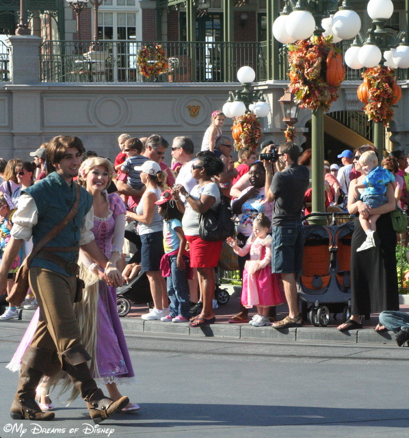 The happy couple, holding hands as the walk around Town Square!