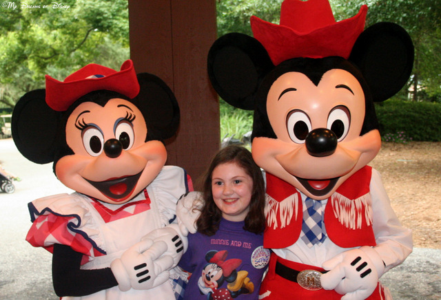 Over at Mickey's Backyard BBQ, Sophie gets her picture taken with Mickey & Minnie!