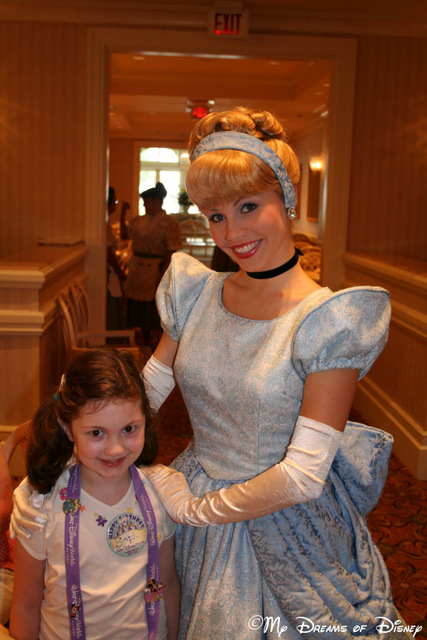 Sophie poses with Cinderella for a picture at 1900 Park Fare!