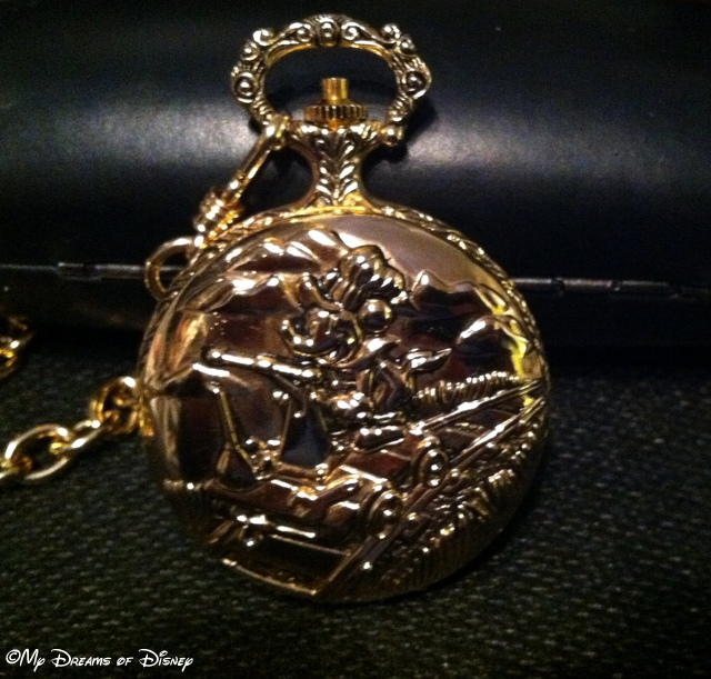 The front of my pocket watch is Mickey using his Handcar!