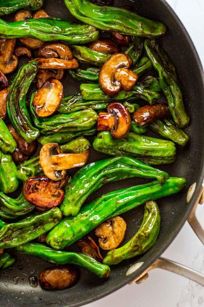 Shishito pepper and mushroom stir fry in the pan
