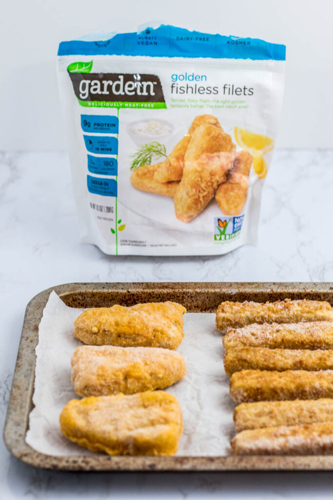 a picture of both frozen fish sticks and fishless filets before baking in the oven
