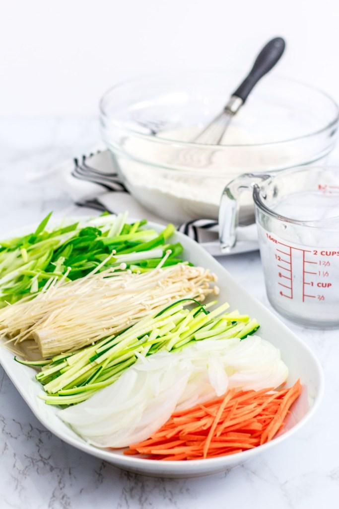 flour batter, scallion, enoki mushroom, zucchini, onion, and carrot