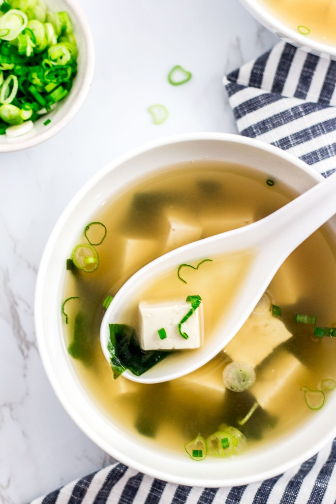 vegan miso soup with green onion garnish