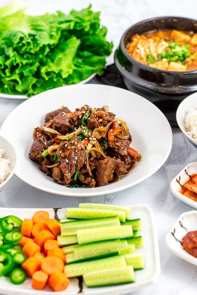 lettuce, seitan bulgogi, Korean bean paste soup, and other Korean BBQ side dishes