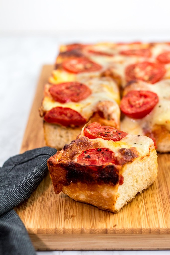 Close up shot of a piece of vegetarian Detroit style pizza