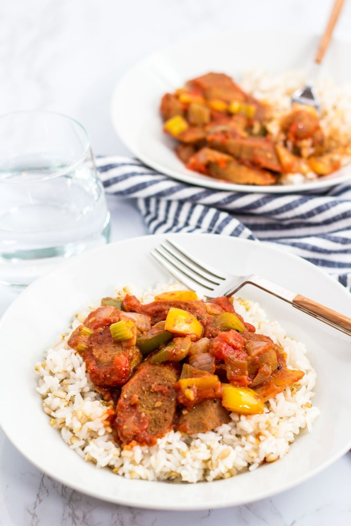 two bowls of vegan creole sausage cacciatore over rice