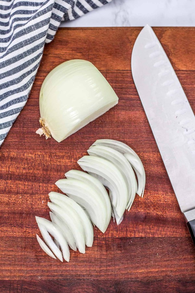 very thinly sliced onion ready to be minced