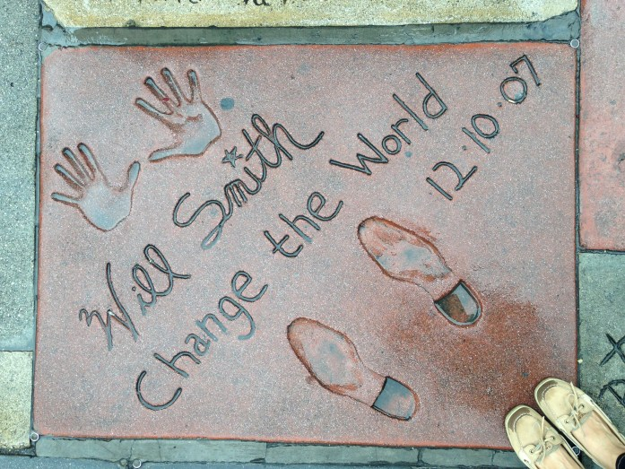 In Hollywood, California at Will Smith's cement handprints and footprints at Grauman's Chinese Theatre.