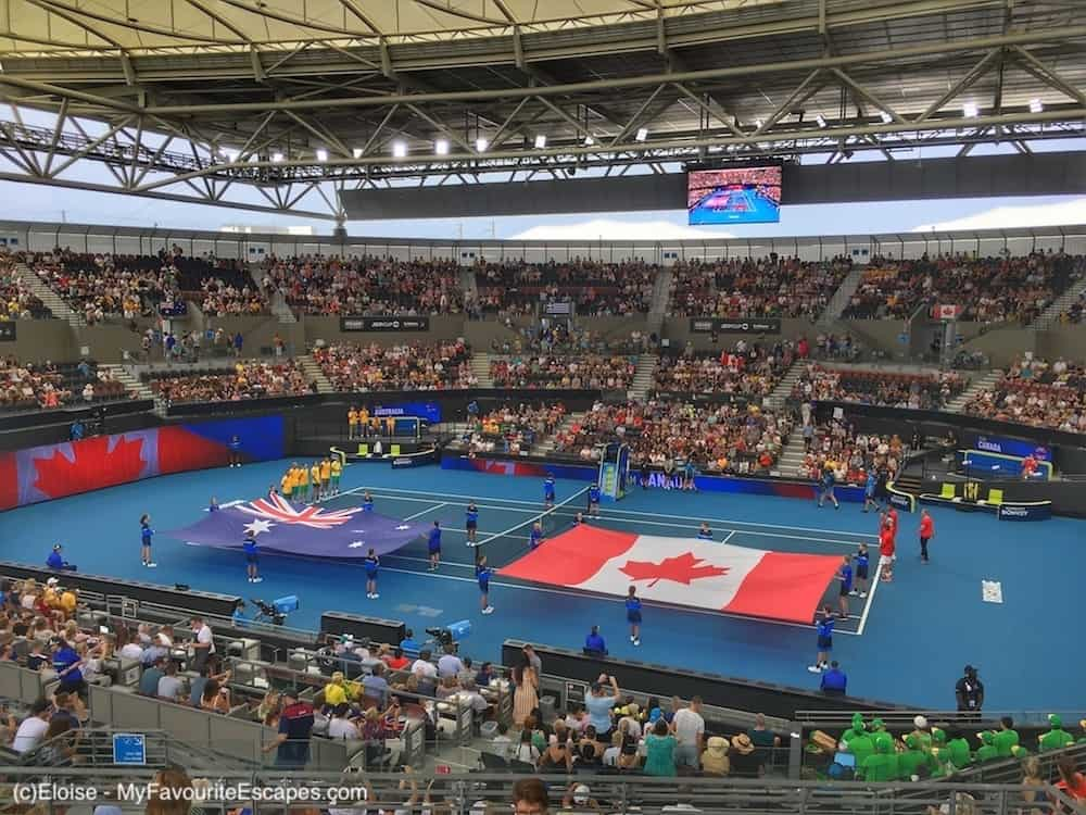 Australia vs Canada at the ATP Cup in Brisbane. The flags are on the tennis court.