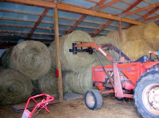 storing round bales in the barn 3