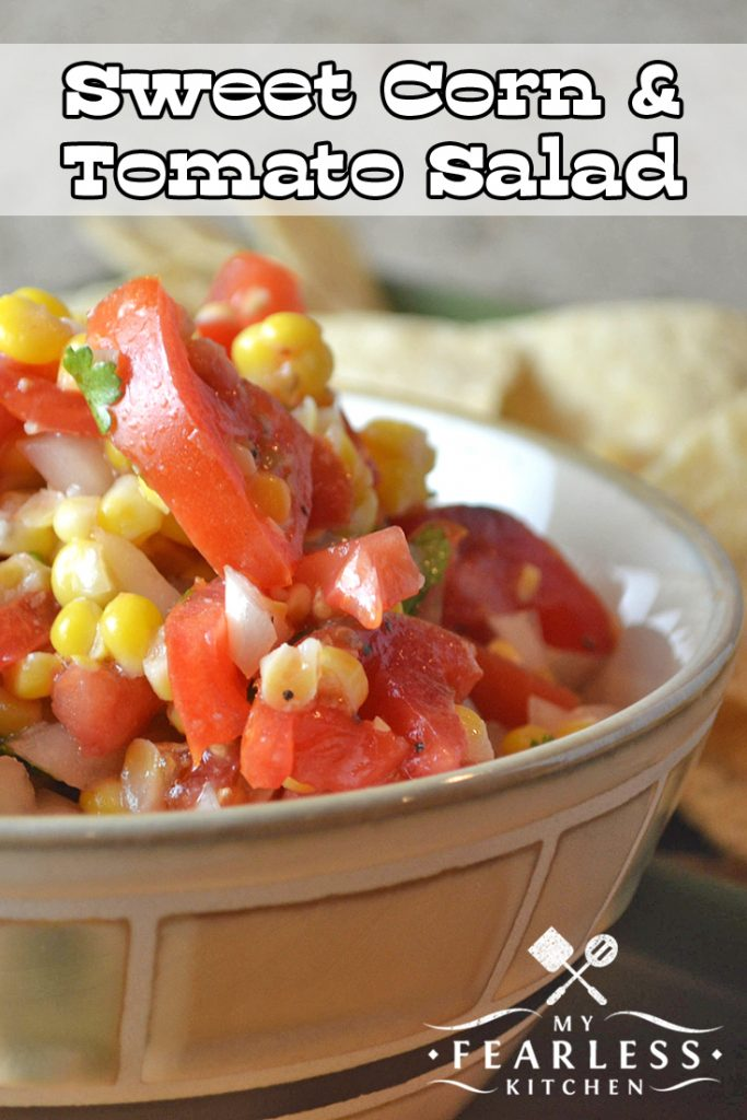 Sweet Corn & Tomato Salad from My Fearless Kitchen. This Sweet Corn and Tomato Salad is a wonderful cold salad, packed with tons of summer flavor. Use fresh sweet corn, or substitute canned or frozen! #corn #tomato #salad