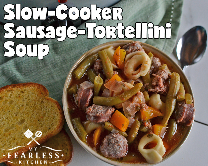 Slow Cooker Sausage-Tortellini Soup from My Fearless Kitchen. This Slow Cooker Sausage-Tortellini Soup recipe will be a staple in your kitchen! It's packed with vegetables, sausage, and delicious tortellini.