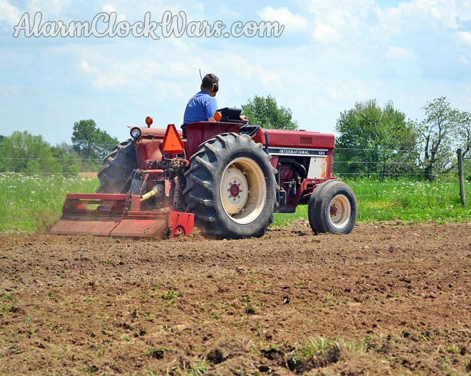 Farmer Doc tills the huge garden with the tractor to get the ground ready to plant in the spring.