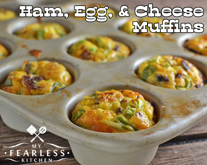 close up of ham, egg, and cheese muffins in a stoneware muffin pan