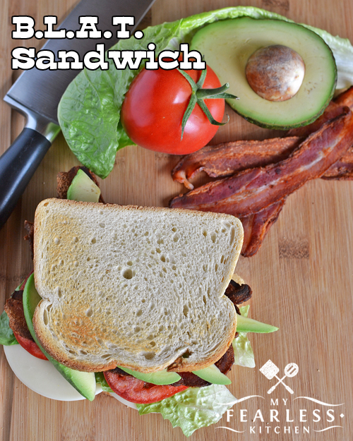 bacon, lettuce, tomato, and avocado sandwich on toasted white bread