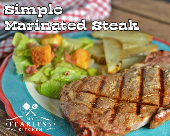marinated ribeye steak with a salad and thick-cut potatoes