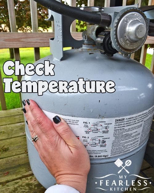 check the temperature of the outside of a propane tank to see how full it is
