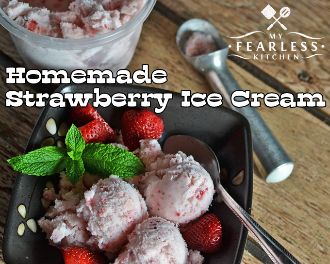 three scoops of strawberry ice cream with fresh strawberries and a mint garnish