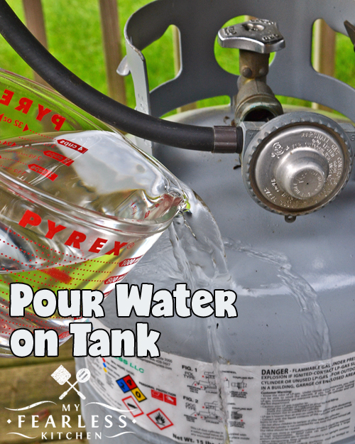 pour warm water over a propane tank to see how full it is