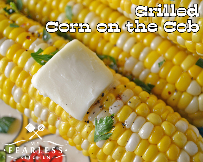 a pat of butter on grilled sweet corn on the cob