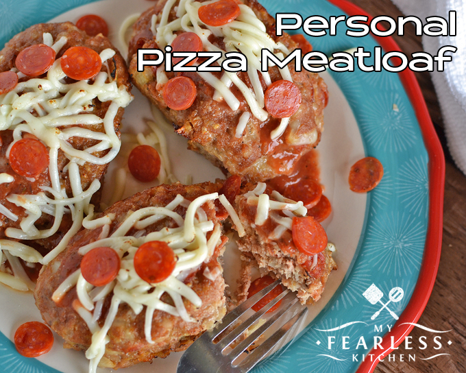 flat lay of Personal Pizza Meatloaf topped with shredded mozzarella cheese and mini pepperoni