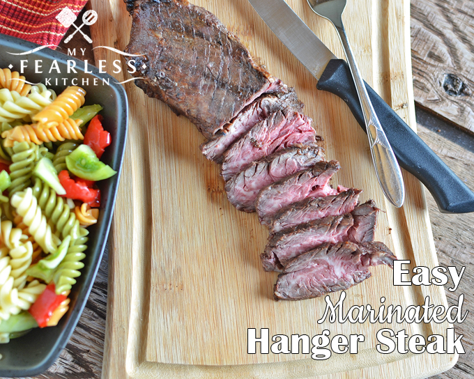 medium-rare Easy marinated Hanger Steak on a bamboo cutting board