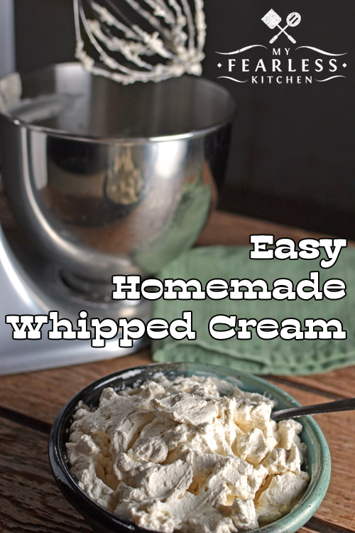 homemade whipped cream with an electric mixer in the background