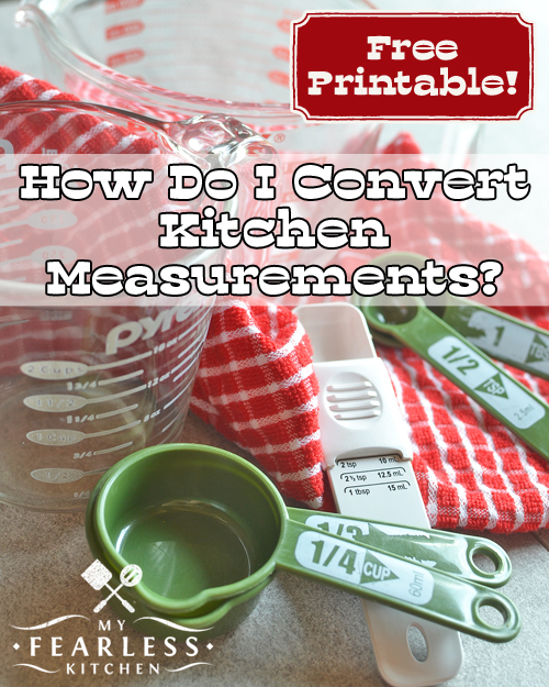 measuring cups and measuring spoons with a red plaid kitchen towel