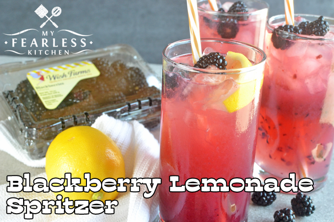 blackberry lemonade spritzers in tall glasses