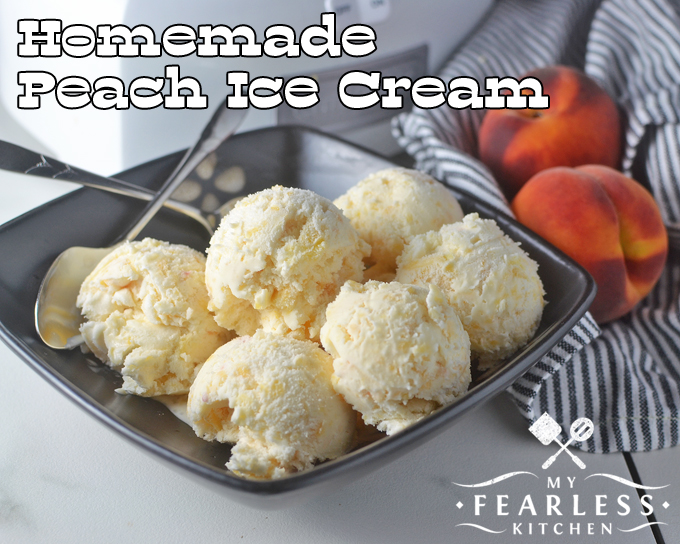 Homemade peach ice cream my fearless kitchen scoops of peach ice cream in a dark bowl with fresh peaches in the background ccuart Images