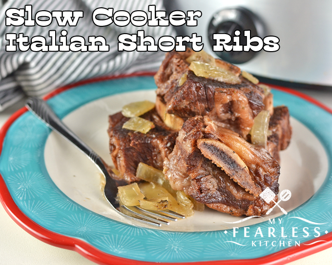 Slow Cooker Italian Short Ribs on a plate in front of a slow cooker
