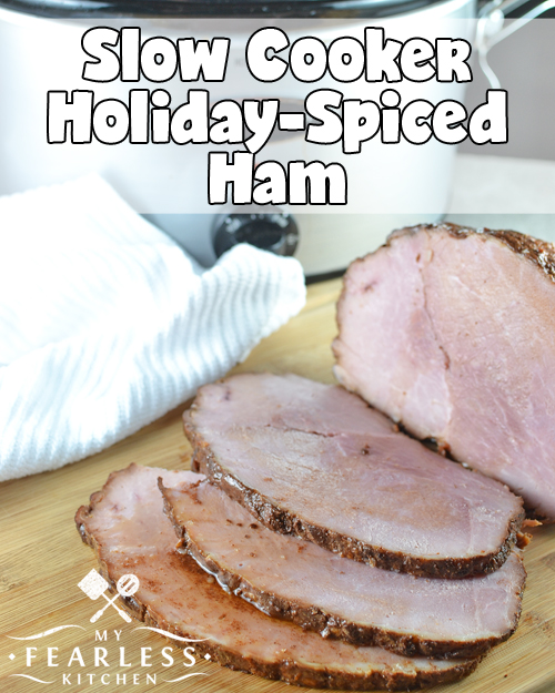 boneless ham, sliced on a wooden cutting board
