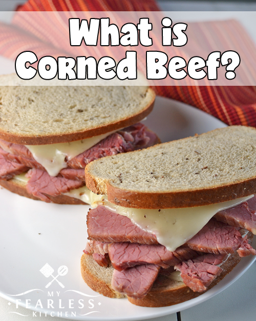 two thick-sliced corned beef sandwiches on seeded rye bread