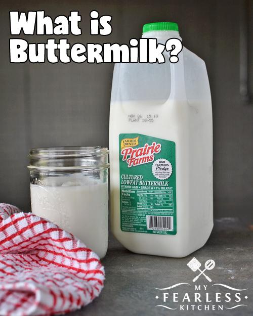 buttermilk in a mason jar next to a half-gallon container of buttermilk