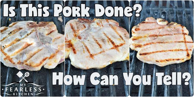 three pork chops on a grill