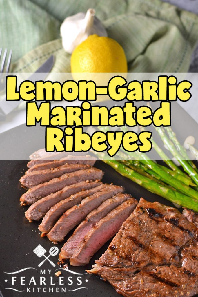 Lemon-Garlic Marinated Ribeyes from My Fearless Kitchen. The simple marinade for this Lemon-Garlic Marinated Ribeye Steak only takes a few minutes to make, but packs a ton of flavor punch! You'll love these steaks for a busy weeknight or a lazy weekend meal. #beefrecipes #steakrecipes #grill #easyrecipes
