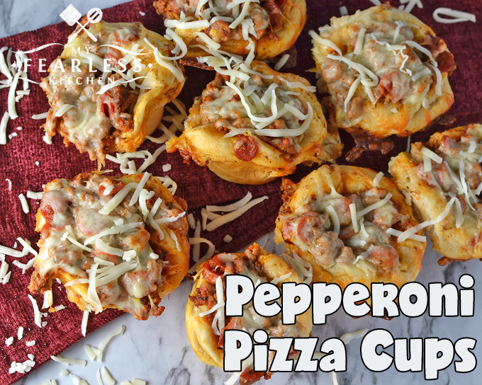 pepperoni pizza cups on a red napkin on a marble background