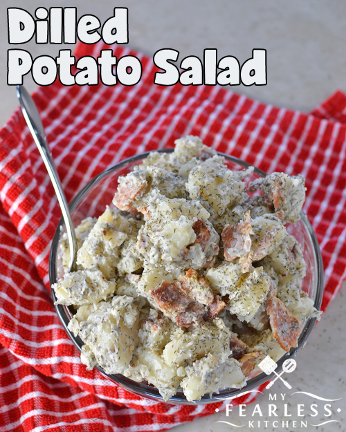 overhead view of bowl of potato salad with dill and bacon