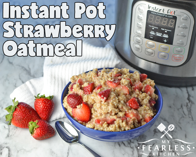 steel-cut oatmeal with strawberries in a blue bowl in front of an Instant Pot