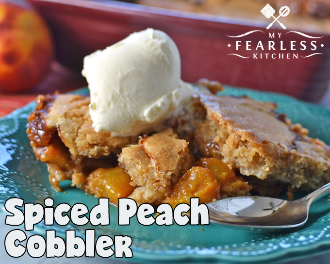 Spiced Peach Cobbler from My Fearless Kitchen. This dessert is a tasty spin on a traditional one we all love. Everyone will be wanting seconds of this delicious and easy Spiced Peach Cobbler!