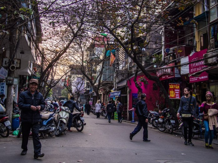 On the streets of Hanoi at sunset.