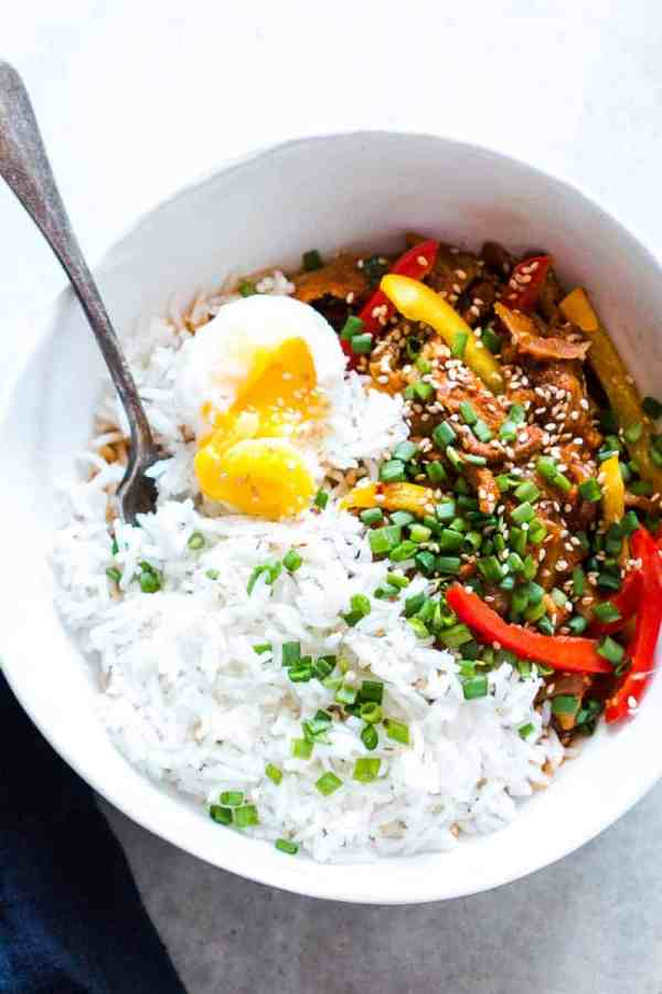 Easy Slow Cooker Korean Pork Bulgogi recipe that can be made in a crockpot and has spicy gohujang in it's marinade. Healthy, yummy stew that's perfect over rice for dinner!